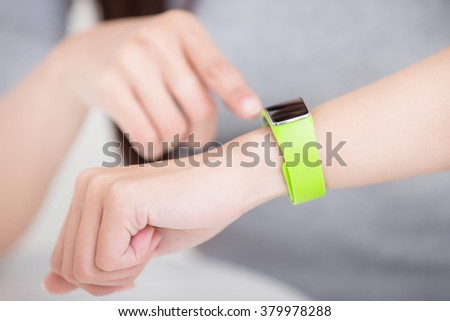 smile young woman use smart watch at home, healthy lifestyle concept, asian beauty