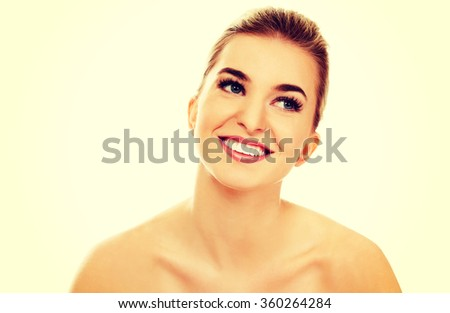 Smiled young naked woman - stock photo