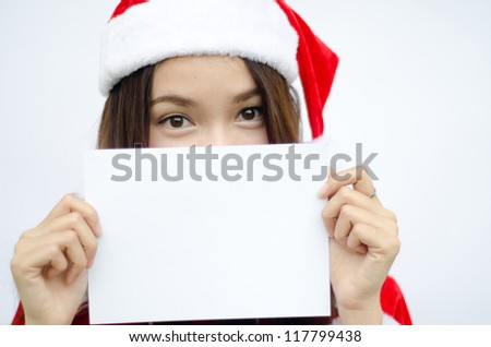 Smiley Asian santa woman with copyspace. isolated on white background