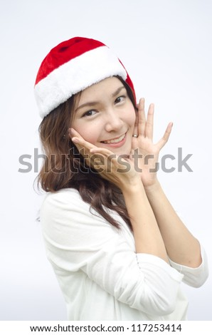 Smiley Asian woman in santa hat. isolated on white background