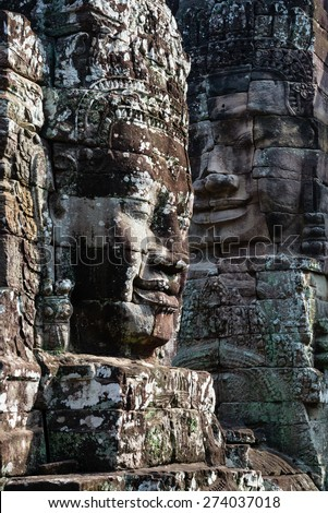 Smiley Bayon face, well known and rich decorate locate at Siem Reap province, Cambodia, Ankor Thom - stock photo
