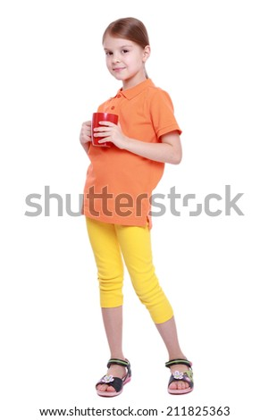 Smiley beautiful little girl drink tasty red tomato juice on Food and Drink theme