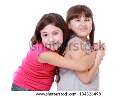smiley beautiful sisters isolated over white