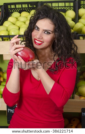 Smiley beautiful young woman holding mango fruit in her hands, selective focus on face. Weight loss nutrition  - stock photo
