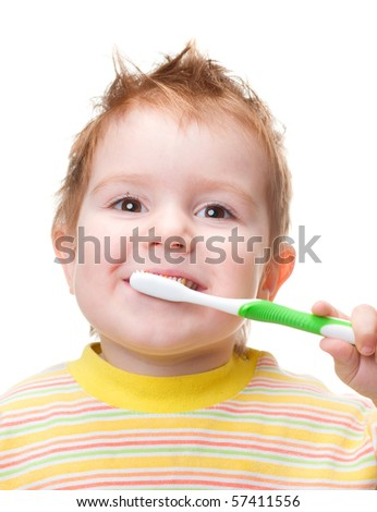 smiley boy cleans a teeth isolated on white background - stock photo