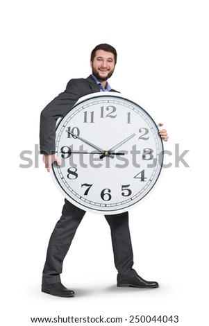 smiley businessman with big clock going forward. isolated on white background