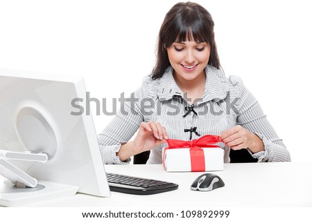 smiley businesswoman making christmas gift