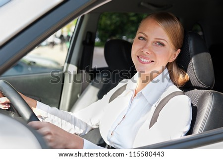 smiley caucasian female in the car