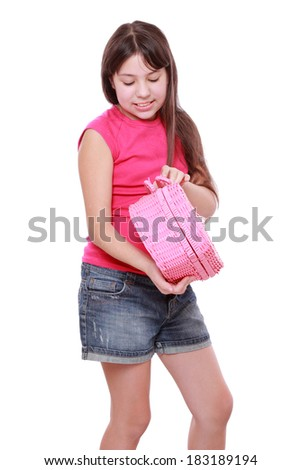 Smiley caucasian sweet little cute girl holding a picnic basket