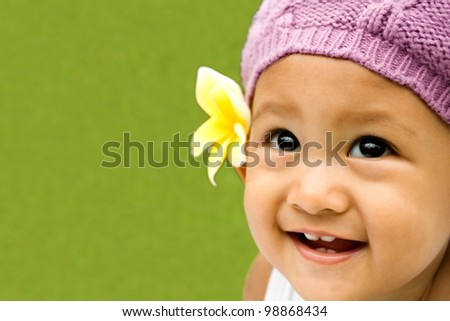 smiley face of an adorable asian toddler girl - stock photo