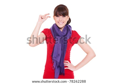 smiley female indicating a little bit against white background - stock photo