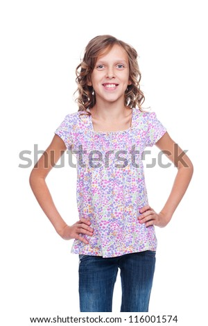 smiley girl of about ten with curly hair. isolated on white background - stock photo