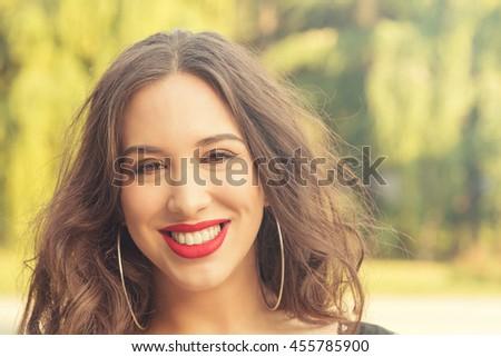 Smiley girl on the street. - stock photo