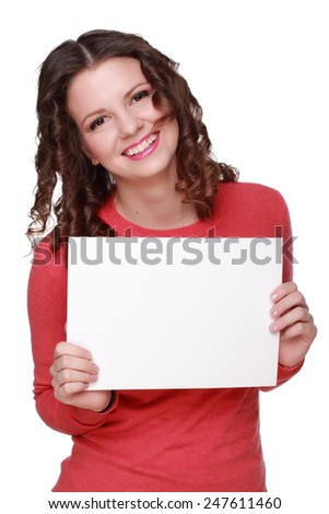 Smiley girl wearing casual red sweater holding blank on white background - stock photo