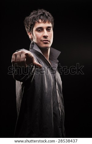 smiley handsome man in grey shirt select you - stock photo
