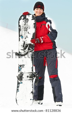 smiley happy woman with snowboard at winter outdoors - stock photo