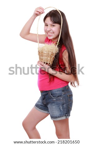 Smiley kid holding spring basket with Easter eggs