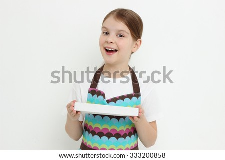 Smiley little girl eating sweet paste from town Kolomna, russia - stock photo