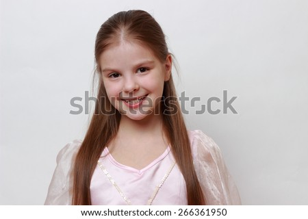 Smiley little girl wearing pink dress as a princess - stock photo
