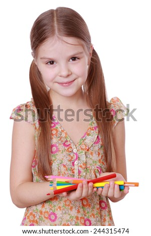 smiley little girl with colorful pencils - stock photo