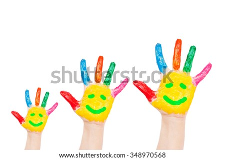 Smiley on family hands. Symbol happiness, joy and having fun concept. Isolated on white background.