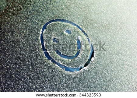 Smiley on glass in a frost - stock photo
