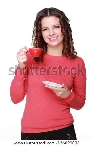 Smiley positive thinking young caucasian curly brunette hair woman holding coffee cup - stock photo