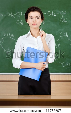 Smiley teacher at the blackboard