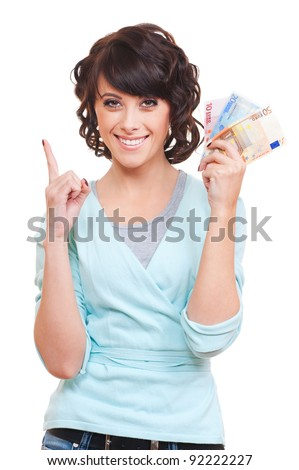 smiley woman holding money and pointing up. isolated on white background - stock photo