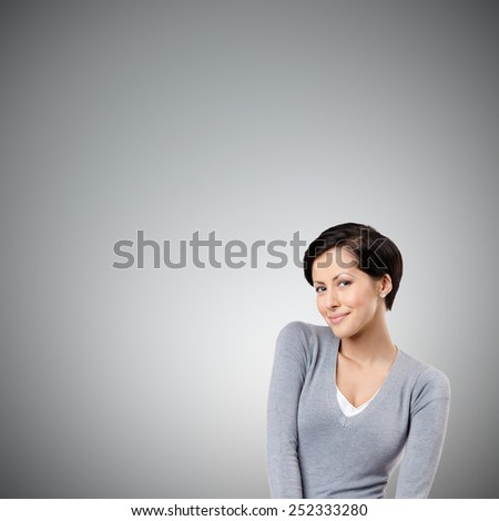 Smiley woman, isolated on grey background - stock photo