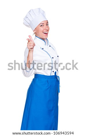 smiley young cook pointing finger. isolated on white background - stock photo