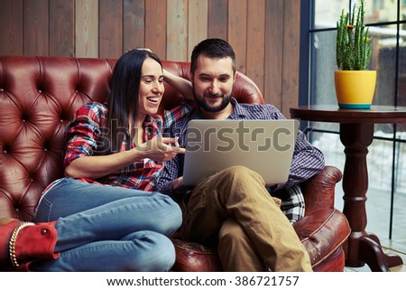 smiley young couple have a on-line shopping