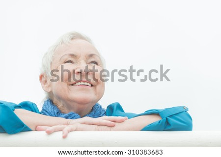 Smililing senior woman with grey hair