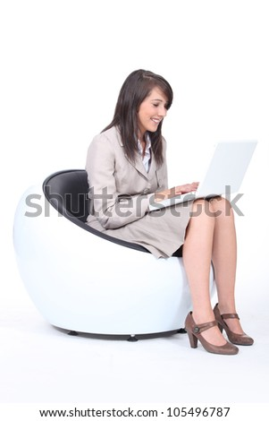 Smiling accountant in armchair