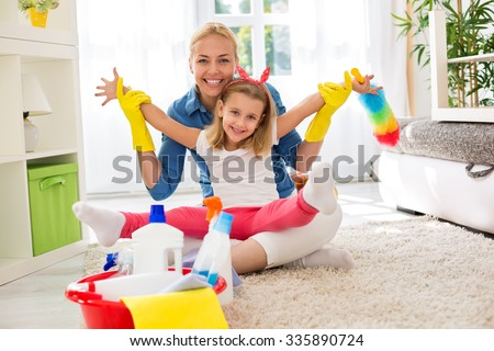 Smiling adorable family ready for cleaning house together - stock photo