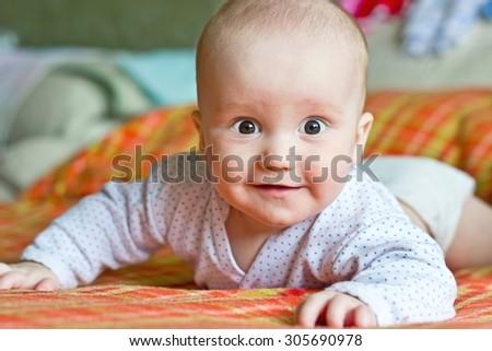 Smiling adorable little boy portrait. Looking at lens - stock photo