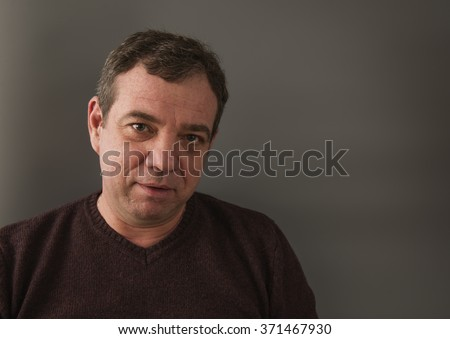 Smiling adult man - stock photo
