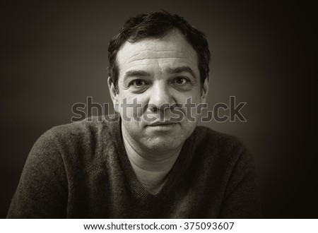 Smiling adult man.  Black and white photo