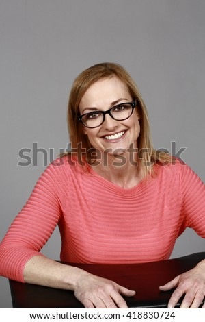 smiling adult woman in glasses