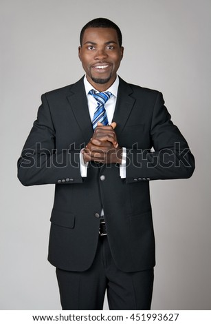 Smiling African American businessman, friendly and welcoming.