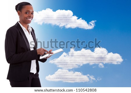 Smiling african american businesswoman using a tactile tablet, isolated on white background - stock photo