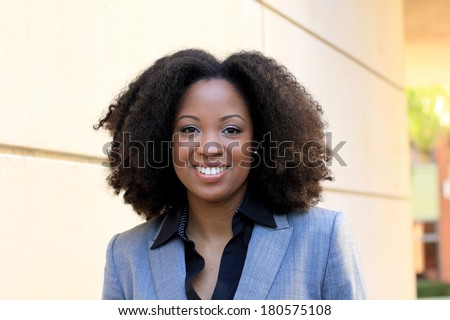 Smiling African American Professional Business Person Pretty Beautiful Wearing Black Shirt and Suit