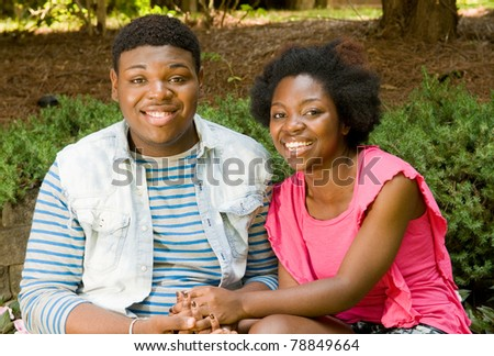 Smiling African American teenage couple