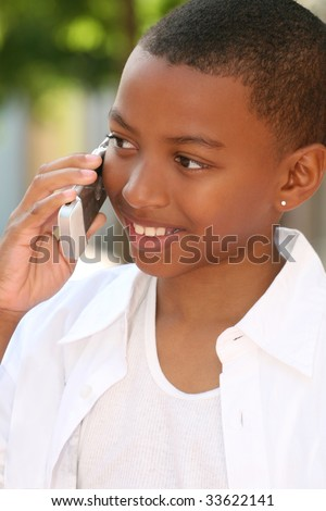 Smiling African American Teenager Boy talking on Cell Phone
