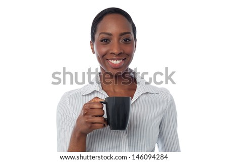 Smiling African business lady enjoying coffee - stock photo