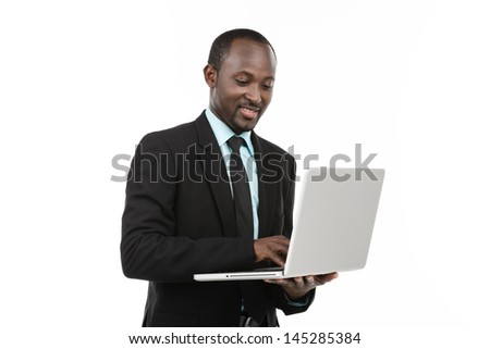 Smiling African Businessman with laptop
