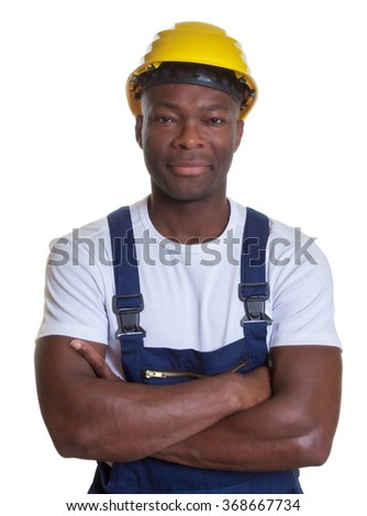 Smiling african construction worker with crossed arms - stock photo