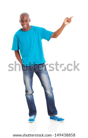 smiling african man pointing at empty copy space over white background - stock photo