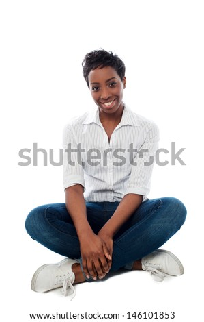 Smiling african woman dressed in casuals