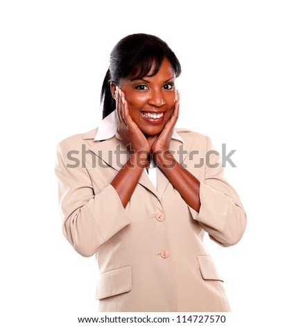 Smiling afro-american executive woman looking at you against white background - stock photo